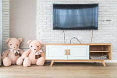 Living room with led tv on brick wall and wooden table Royalty Free Stock Photography