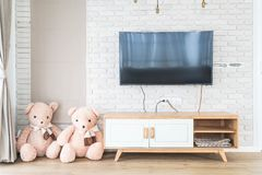 Living room with led tv on brick wall and wooden table Stock Photo