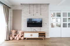 Living room with led tv on brick wall and wooden table Stock Images