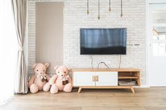 Living room with led tv on brick wall and wooden table Royalty Free Stock Image
