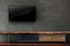 Living room led tv on concrete wall with wooden table media furn Stock Photo