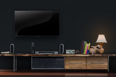 Living room led tvs on concrete wall with lwooden table media fu Royalty Free Stock Images