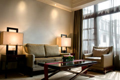 Living room of a luxury 5 star hotel suite. A suite living room of a 5 star hotel at a sunny morning stock photos