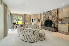 Living room in luxury home. With stone fireplace Stock Image