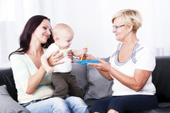 The living room is the mother of the child and the grandmother. Stock Photography
