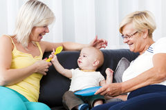 The living room is the mother of the child and the grandmother. Stock Images