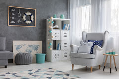 Living room with nautical decor. Contemporary style living room with nautical decor, trendy wall finish and comfortable armchair stock photos