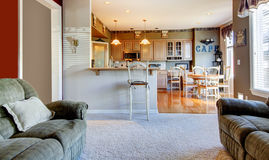 Living room near kitchen with two sofas. Stock Photo