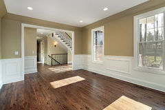 Living room in new construction home. Livng room in new construction home with view into foyer Stock Photo