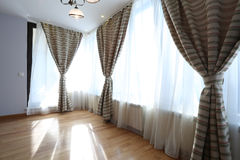 Living room with new curtains Royalty Free Stock Image