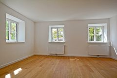 Living room in an old building - Apartment with wooden windows and parquet flooring after renovation Stock Photography