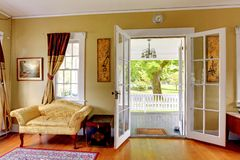 Living room with open doors to the front porch. Romantic classic. Royalty Free Stock Photography