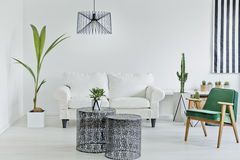 Living room with openwork table Stock Photos