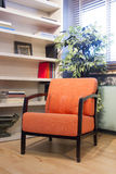 Living room. A orange armchair in a modern living room Royalty Free Stock Photos