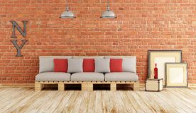 Living room with pallet sofa Royalty Free Stock Images