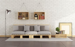 Living room with pallet sofa. And wooden crate with books on brick wall - 3D Rendering Stock Photo