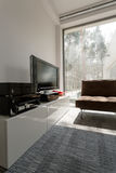 Living room with panoramic window Stock Photo