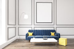 Living room with poster, blue sofa and a coffee table Stock Image