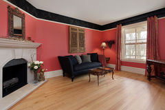 Living room with red walls Royalty Free Stock Photo