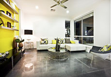 Living room with reflective tile floor and colorful decor Stock Photos