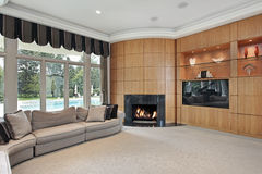 Living room with rounded fireplace. Living room in luxury home with rounded fireplace Stock Photos