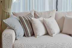 Living room with row of brown pillows on sofa Stock Photos