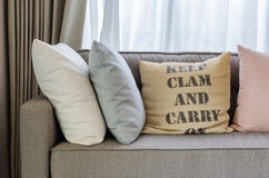 Living room with row of pillows on sofa Stock Images