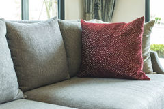 Living room with row of pillows on sofa Royalty Free Stock Image