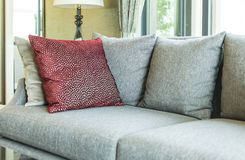 Living room with row of pillows on sofa Stock Photography