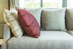 Living room with row of pillows on sofa Stock Photos