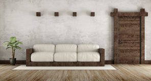 Living room in rustic style. With wooden couch and old wooden door - 3d Rendering Stock Photography