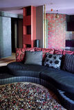 The living room in shades of red Royalty Free Stock Photography