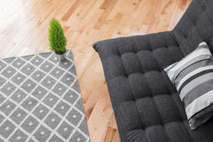 Living room with simple decor. Detail of a bright modern living room with simple decor Stock Photos