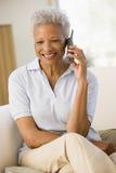 living room sitting telephone using woman Στοκ εικόνες με δικαίωμα ελεύθερης χρήσης