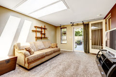 Living room with skylight and exit to backyard Royalty Free Stock Photo