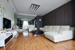 Living room sofa. Clean and spacious room is a good place to live Royalty Free Stock Photography
