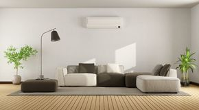 Living room with sofa and air conditioner Stock Photos