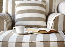 Living room sofa with coffee and book. Home interior decoration background concept Royalty Free Stock Images