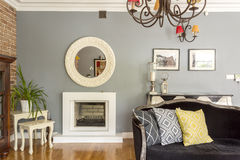Living room with sofa and fireplace Royalty Free Stock Images