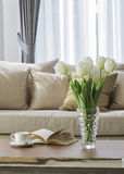 Living room sofa Home interior decoration. Living room sofa with coffee and book on table with white flower Home interior decoration Royalty Free Stock Photos