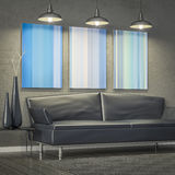 Living room with a sofa and modern art on the wall Royalty Free Stock Photos