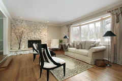Living room with stone fireplace Stock Image