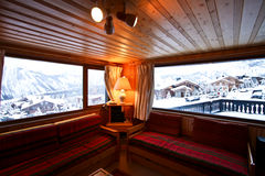 Living room in Swiss Alpine Chalet. Swiss Alpine Chalet with an amazing view royalty free stock images
