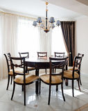 Living room with table for dinner Royalty Free Stock Photography