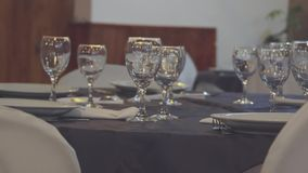Gourmet food salon. Living room with tables prepared for gourmet dishes and bright glasses stock footage