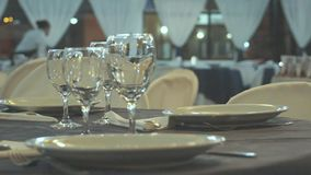 Gourmet food salon Wine glasses. Living room with tables prepared for gourmet dishes and bright glasses stock video
