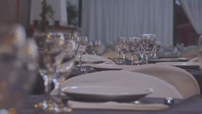 Gourmet food salon Wine glasses. Living room with tables prepared for gourmet dishes and bright glasses stock video footage