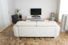 A living room with a television with its furniture royalty free stock photo