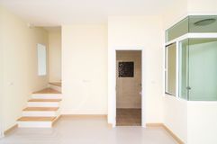 Living room, toilet and staircase in new construction home with Royalty Free Stock Photography