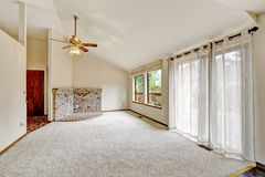 Living room with vaulted ceiling in empty house Royalty Free Stock Photo